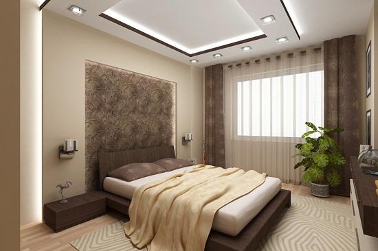 Прямоугольный короб из гипсокартона с точечными светильниками для выделения и декорирования зоны спального места.
